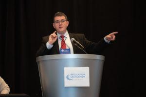 Photo of David Benton speaking at a podium