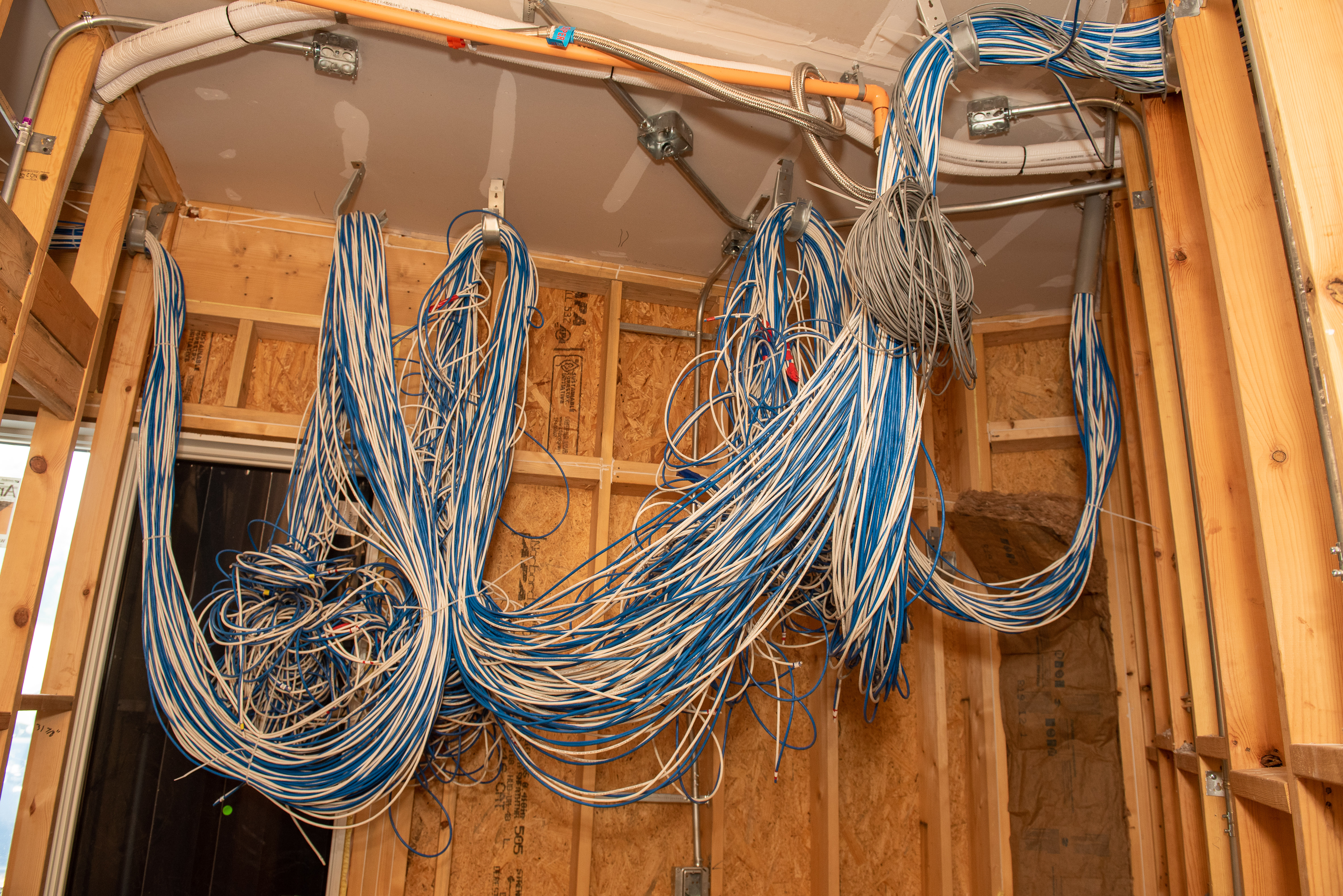 photograph of building construction with thick bundles of computer wiring.