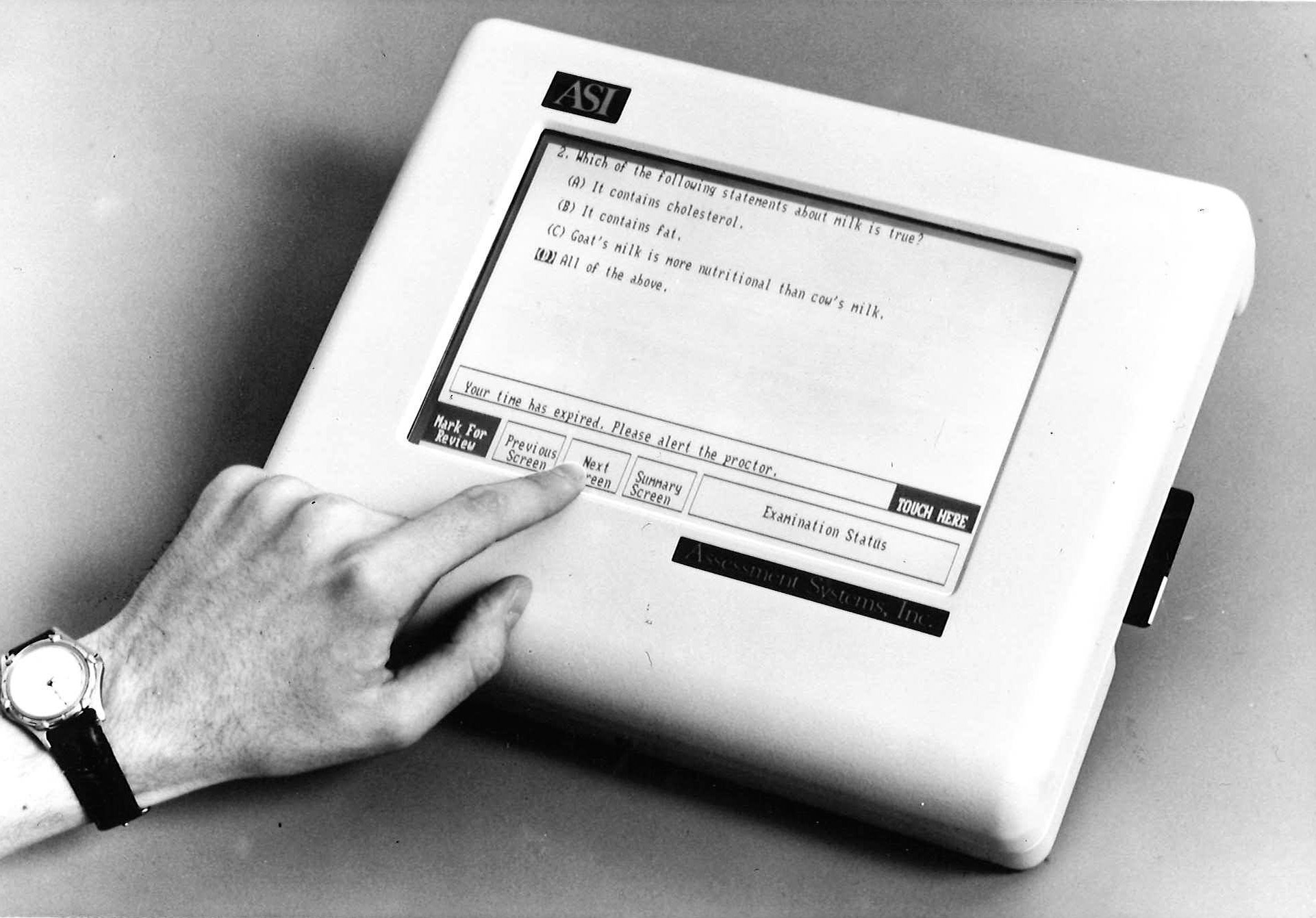 black and white photograph of electronic testing machine with touch screen interface