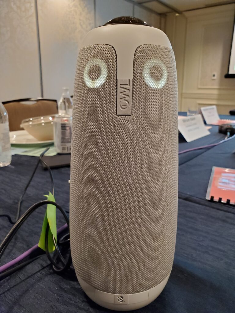Photograph of owl-shaped robot with camera and microphone